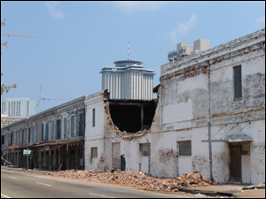 Category 5 winds caused extensive damage, including collapsed walls and complete building collapses.